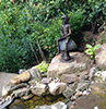 bronze goblin sitting on a toadstool fishing - from Metallic Garden