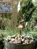 copper Morning Glory water feature in a garden pond - by Gary Pickle of Metallic Garden
