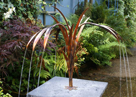 water reed copper water sculpture