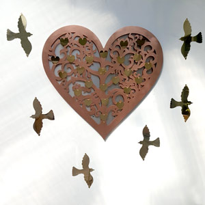 filigree heart with soaring bird plaques